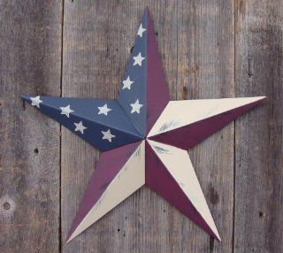 53 Inch Heavy Duty Metal Barn Star Painted Solid Olde Glory. The Colors in the Olde Glory (American Flag) Theme Are Burgundy, Beige, and Whale Blue. The Rustic Paint Coverage Starts with a Black or Contrasting Base Coat and Then the Star Color Is Hand Pain