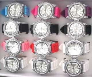 Set of ONE DOZEN 25% DISCOUNT When Compared to Buying Single. Silicone Rubber Gel Watch Link Look Ceramic Style Large Face with Crystal Bezel. MAKES A PERFECT GIFT FOR UNDER $10.00 FOR 12 SPECIAL PEOPLE. Includes 12 Pouches for Easy Gift Giving. Watches