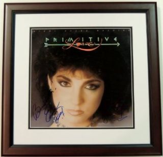 Gloria Estefan and Emilio Estefan Autographed / Hand Signed Miami Sound Machine Primitive Love LP Record Album Cover   MAHOGANY CUSTOM FRAME Gloria Estefan Entertainment Collectibles