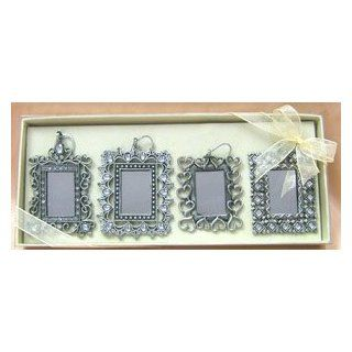 Pewter X mas photo ornaments adorned with Czech rhinestones and beautiful clear gems; This multi functional ornament can be a mirror or photo frame; they can also be hanged or placed on table top. It comes in a set of 4 packaged in a deluxe box. Place the